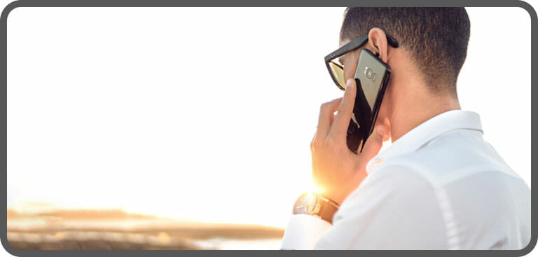 Male employee using VoIP mobile phone remotely