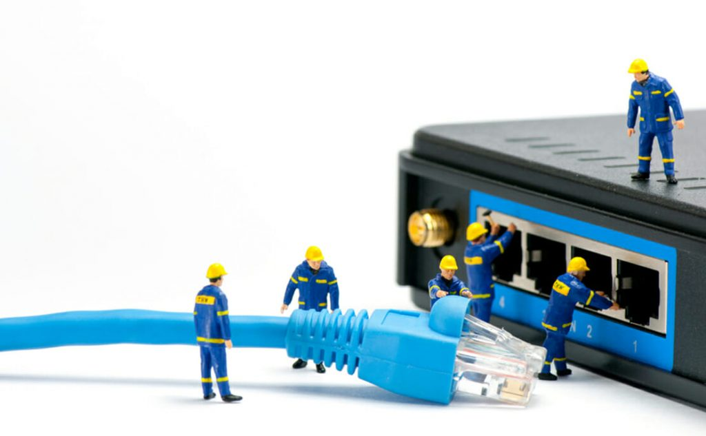 Men Plug Internet Cable in Router