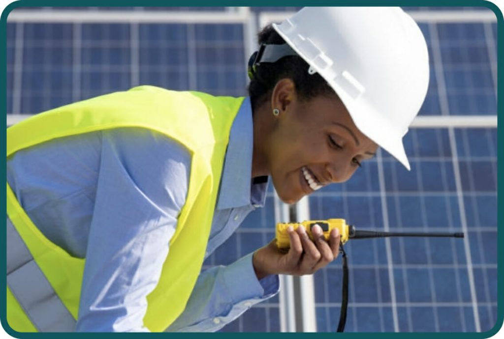 Female construction worker with walkie-talkie two-way radio receiver