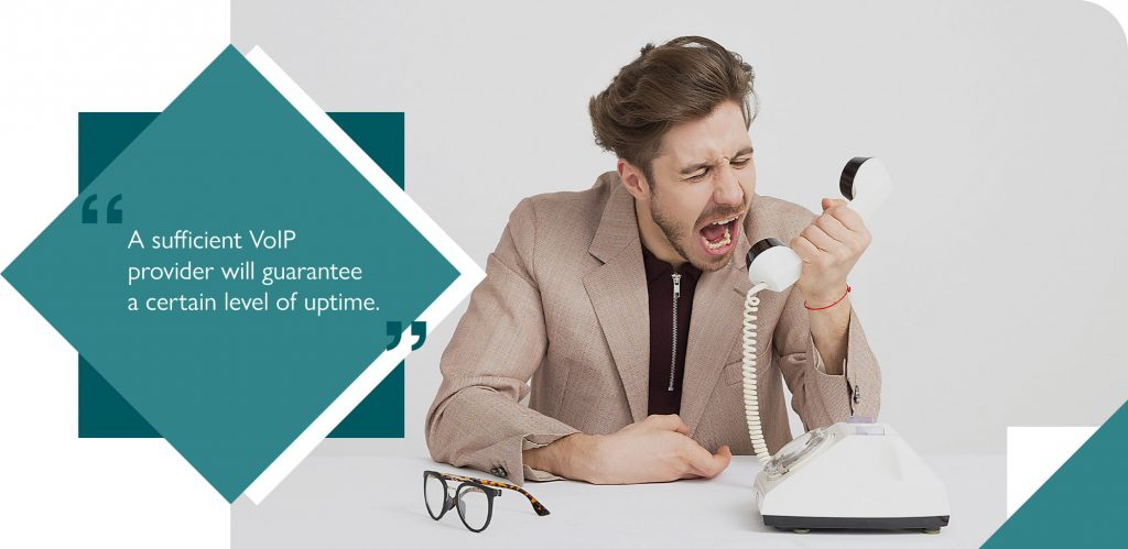 Frustrated employee shouting at unreliable VoIP phone