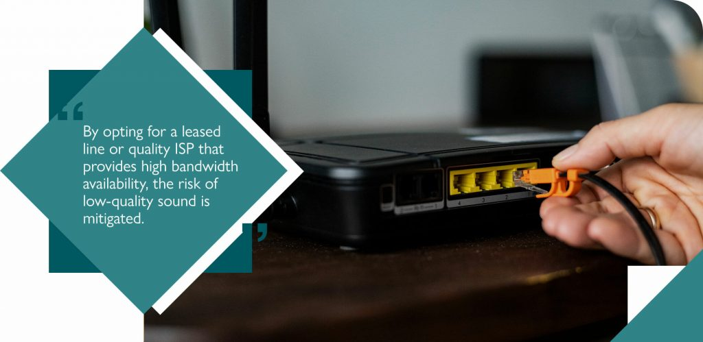 Ethernet cable being plugged into black broadband router to reap VoIP advantages