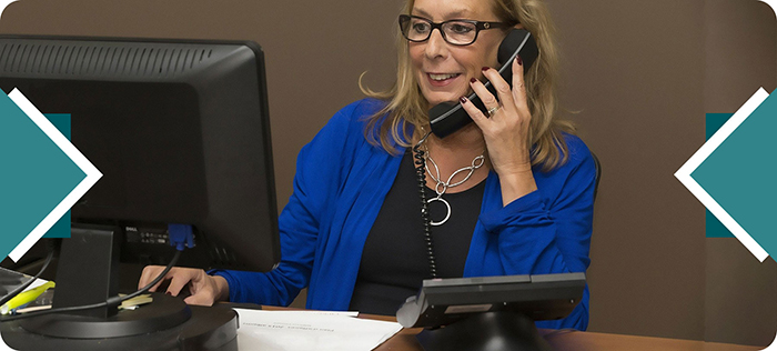 Female employee using VoIP handset